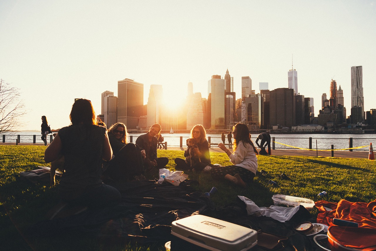Group of friends at a picnic at sundown